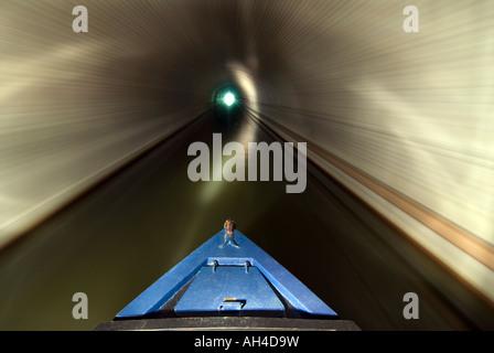 Narrowboat navigating along the English canal system - Stock Photo