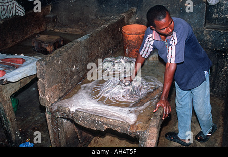 Fresh octopus being prepared for sale in the fish section of the market Stone Town Unguja Zanzibar Tanzania East - Stock Photo