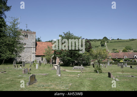 St Mary s church in the chiltern village of Turville and windmill on the hill have been used many films and TV programmes - Stock Photo