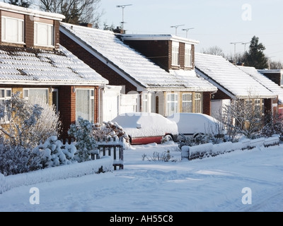 Essex typical residential road after fresh snowfall covers everything with a white blanket - Stock Photo