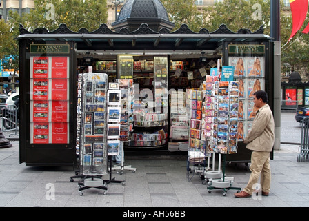 Paris Avenue Champs Elysees card postcard magazine and newspaper kiosk stall on pavement  France Europe - Stock Photo