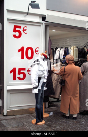 Paris Les Halles clothing shop entrance displaying large sign with price indicators in Euro currency - Stock Photo