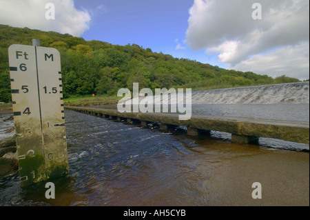 A ford and weir on the River Tavy at Lopwell Devon Great Britain - Stock Photo