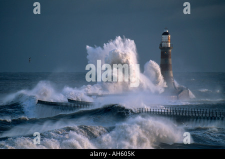 A huge wave breaks over the lighthouse on Roker Pier, during a winter storm. Sunderland. Tyne & Wear. - Stock Photo