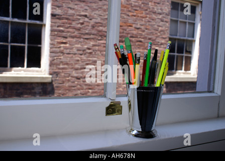 Pencils In A Cup on Windowsill - Stock Photo