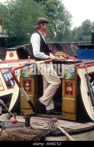 A man in traditional canal costume on the restored steam narrowboat President Grand Union Canal Batchworth Herts - Stock Photo