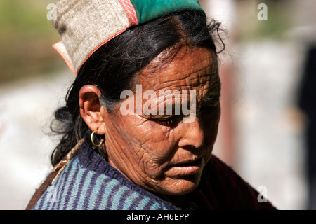 Closeup of an elderly woman busy in her daily routine in village Chitkul, Himachal Pradesh, India - Stock Photo