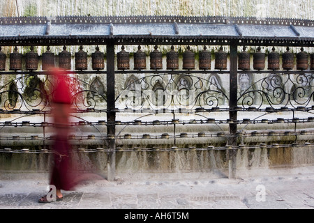 Long exposure of a Buddhist monk walking around Swayambhunath stupa, Kathmandu, Nepal - Stock Photo