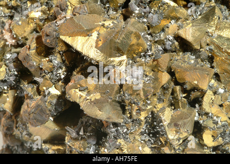 Mineral Chalcopyrite, Chalcopyrite crystals covered in small tetrahedrite and galena crystals on a matrix of sphalerite - Stock Photo