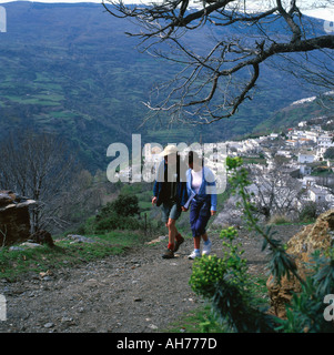 A young couple walking in the hills above Bubion Alpujarras Village Pampaneira Andalucia Spain - Stock Photo