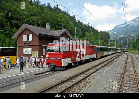 Golden Pass Train arriving at Brunig-Hasliberg on the Brunig Line from Luzern to Interlaken in Switzerland - Stock Photo