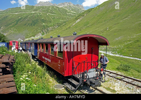 Furka Steam train pausing to take water en route from Realp to Gletch in Switzerland - Stock Photo