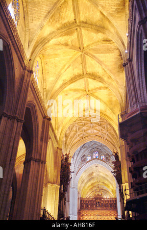 Interior arches columns and vaulted ceilings of the Cathedral of Seville in Andalusia Spain - Stock Photo