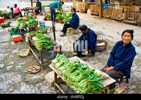 Dong Women Selling Vegetables in a small Market Zhaoxing China - Stock Photo