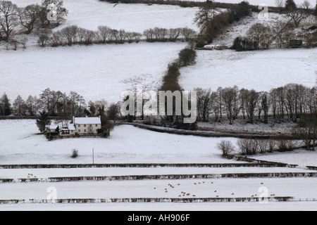 Isolated farms in the Brecon Beacons covered in the first snow of winter Powys Wales GB UK - Stock Photo