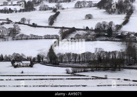 Isolated farms in the Brecon Beacons covered in the first snow of winter Powys Wales UK GB - Stock Photo