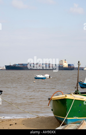 A container ship arrives.  The extensive traffic of ships to Felixstowe can be seen from the seafront of the nearby - Stock Photo