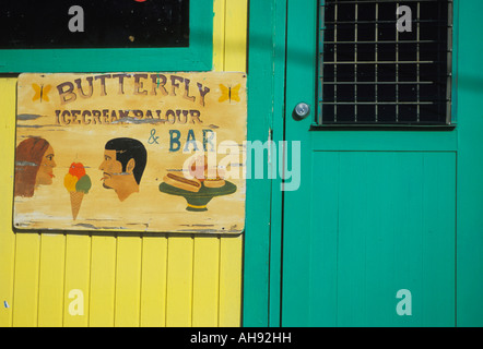 Icecream Parlor Sign on wall of village store on Caribbean islands of Virgin Gorda in the Caribbean - Stock Photo