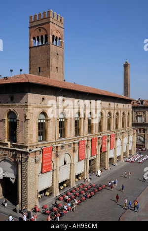 Piazza Maggiore towards Palazzo Re Enzo and Asinelli Tower, Bologna, Italy - Stock Photo