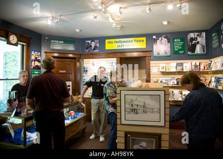 ILLINOIS Dixon Gift shop interior of Visitors Center at Ronald Reagan boyhood home site shoppers view merchandise - Stock Photo