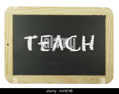 Chalk board with the label teach Symbol for school learning and instruction - Stock Photo