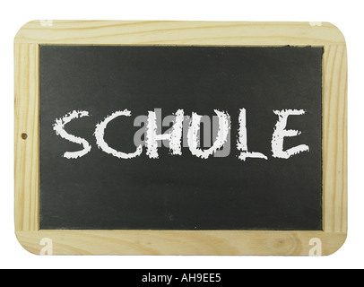 Chalk board with the label school Symbol for school learning and instruction - Stock Photo
