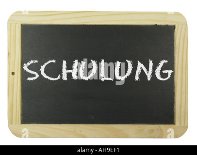 Chalk board with the label training Symbol for school learning and instruction - Stock Photo