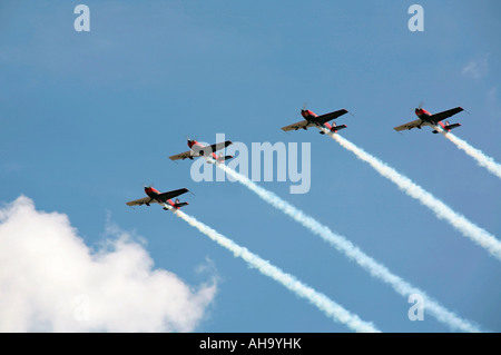 Blades aerobatic display team flying in four Extra 300LP aircraft - Stock Photo
