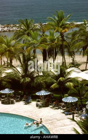 Venezuela Macuto Sheraton Hotel poolside Caribbean Sea - Stock Photo