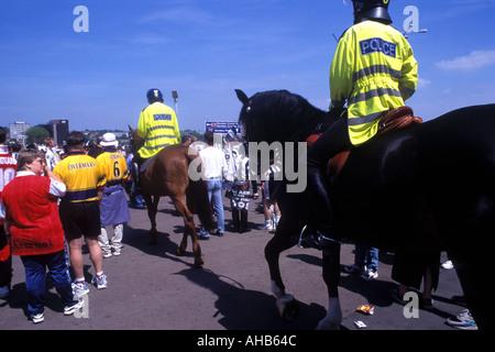 Metropolitan Mounted Police on duty at a football match London England UK - Stock Photo