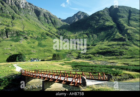 Biean nam Bian viewed from Loch Achtriochtan and River Coe in Glen Coe Scotland with bridge crossing Rive Coe - Stock Photo