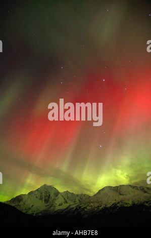Northern Lights or Aurora Borealis over the Chugach National Forest near Seward Alaska - Stock Photo