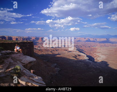 Tourists above Buck Canyon in Canyonlands National Park Utah - Stock Photo