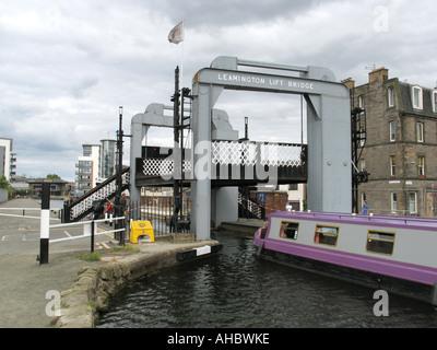 Narrow boat passing under the Leamington Lift Bridge on the Union Canal near Lochrin Basin, Fountainbridge, Edinburgh, - Stock Photo