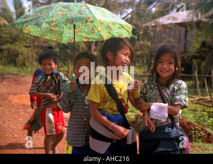 Portrait school girl boy look walk go run smile laugh happy umbrella colour sun shade Luang Prabang Laos Southeast - Stock Photo