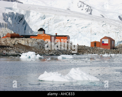 Penguin rookery at the Gonzalez Videla station on Waterboat Point near Paradise Harbor Antarctica Chilean base - Stock Photo