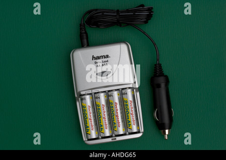 Car charger with four high capacity 2500mA hr rechargeable AA batteries UK - Stock Photo