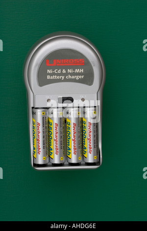 Mains charger with four high capacity 2500mA hr rechargeable AA batteries UK - Stock Photo