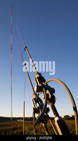 Prairieville Michigan Steel cables anchor a tall communications tower in a farmer s field - Stock Photo