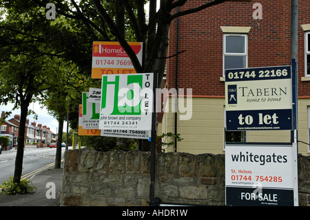 for sale and to let signs on new properties in st.helens north west england - Stock Photo