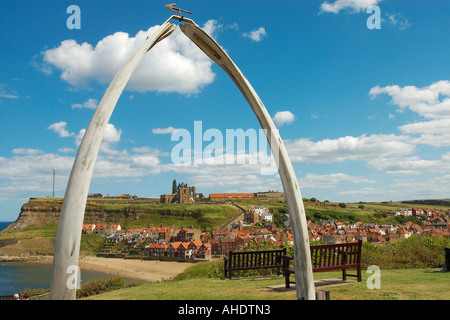 Whitby harbour St Marys church and abbey ruins through a whale bone arch North Yorkshire England - Stock Photo