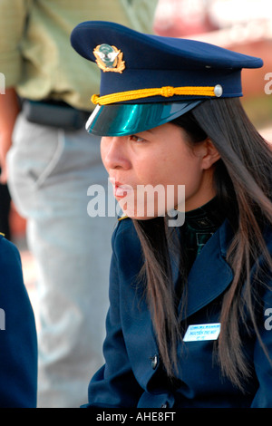 Vietnam , Halong Bay , serious pretty young port , policewoman or police woman with long black hair on quay boats - Stock Photo