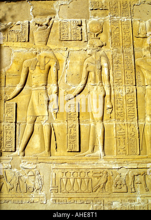 A temple relief at Edfu depicting the 'Beautiful Meeting of Horus and Hathor' - Stock Photo