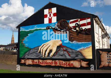 loyalist red hand of ulster legend murals in the Lower Shankill Road area of West Belfast Northern Ireland . - Stock Photo