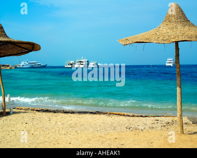 Public beach with dive boats in Hurghada - Stock Photo