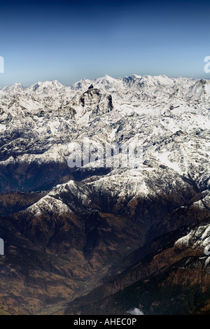 Portrait format aerial view of Snowcapped Himalayan peaks over their foothills - Stock Photo