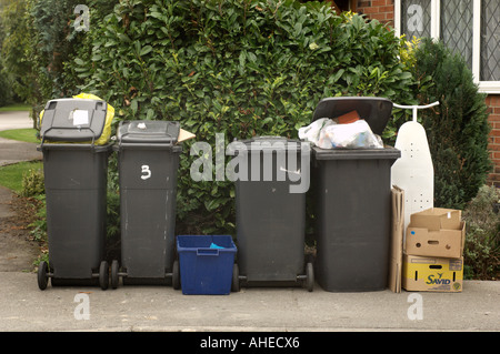 row of wheely bins waiting to be emptied - Stock Photo
