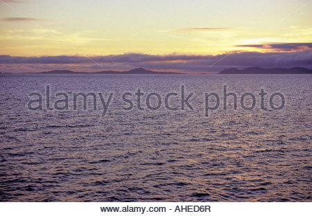 Isle of Eriskay and South Uist Scotland as seen from the ferry - Stock Photo