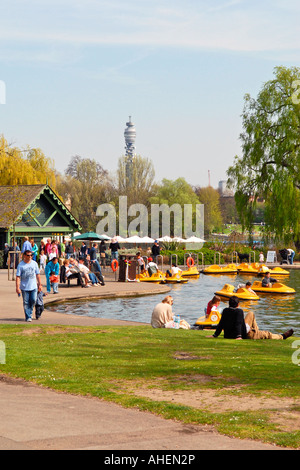 UK , London , Regent's Park , children's boating lake with the Post Office tower in background in Spring sunshine - Stock Photo