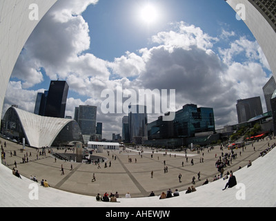 Fisheye view of La Defense Paris from below the Grande Arche with sun in the frame - Stock Photo